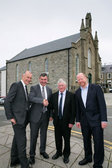 Chris Dowle, Harper MacLeod chairman Professor Lorne Crerar, Paul Rutherford and Harper MacLeod partner Donald Munro outside the DSR offices at St Olaf's Hall in Lerwick. Photo John Coutts)