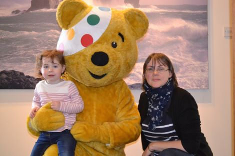Anne-Lise Anderson and her daughter Astrid meet Pudsey, the Children in Need bear.