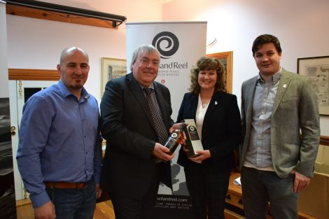 Pictured at the launch of a new Shetland whisky (from left): distillery manager Mark Turnbull, VisitScotland chief executive Malcolm Roughead, distillery co-owner Debbie Strang and product developer Marc Watson. Photo: Shetnews/Neil Riddell