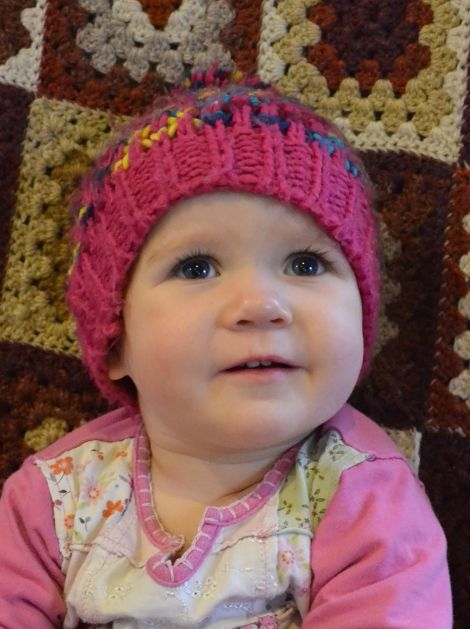 """Shetland Solidarity with Refugees is urging islanders to get knitting. The group's Inger Louise Kristiansen, whose daughter Johanne (pictured) is 1, said it was a chance to """"help make a pretty horrible experience a little bit more comfortable"""" for children living in camps this winter. Photo: Shetnews/Neil Riddell"""