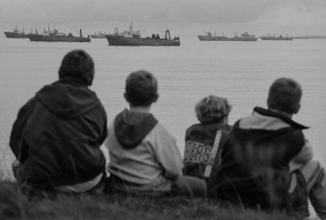 Kids in Lerwick watch the klondykers from the safety of the banks. Photo Jeremy Sutton-Hibbert