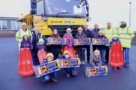 Winners and runners up in the council's 'Name a Gritter' competition, with Roads staff and Councillors. Photo: SIC