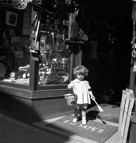 This image, by J. Peterson from 1938 showing a young girl at the door of E J Yates toy shop is one of the images that can be printed using the museum's new service