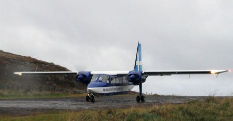 Flying no more. An Islander aircraft operated by Direct Flight for Shetland Islands Council touches down on Scotland's shortest runway.