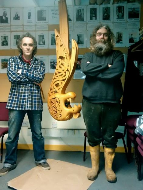 """Craftsman Paul """"Pablo Ritchlovski"""" Ritch, his toothy creation and Wirmtongue himself in the workshop."""