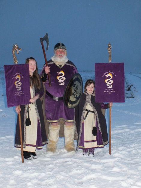 Cullivoe guizer jarl John Saunders (aka Harald Finehair) with his two princesses, niece Bernadette (left) and granddaughter Jolie.