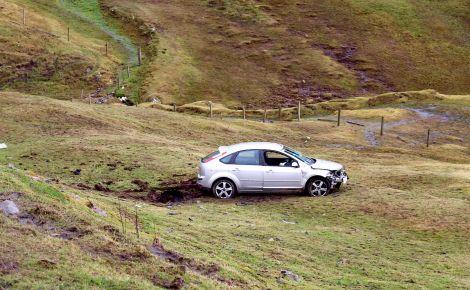 The silver Ford Focus went down the embankment near the Black Gaet junction - Photo: ShetNews