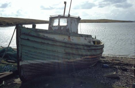 Lying abandoned on the beach at Ulsat after being used to carry sheep across Yell Sound. Photo Shetland Museum and Archives