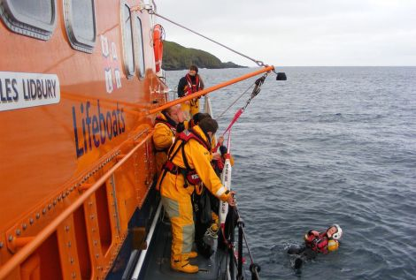Elizabeth Atia in the water during a woman overboard exercise with the Aith lifeboat.
