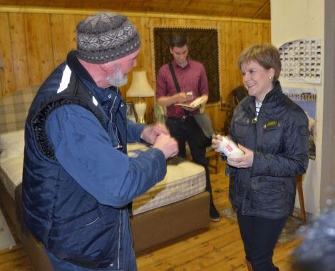 Nicola Sturgeon learning everything there is to know about wool from Jamieson & Smith's Oliver Henry on Monday afternoon. Photo: Shetnews/Neil Riddell
