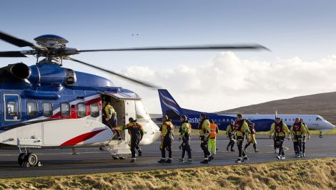 Offshore workers boarding a Bristow-operated helicopter at Scatsta Airport.