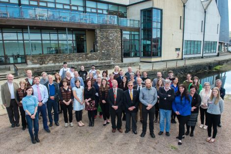 Members of the museum and the archives services along with admin staff from Shetland Amenity Trust and trustees came together for an official anniversary photo on Tuesday - Photo: Malcolm Younger