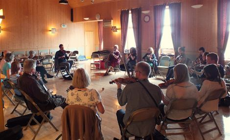 A fiddle workshop held in the Vidlin hall - Photo: Shetland Arts