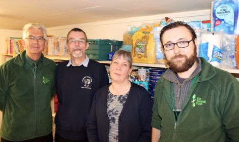 The Trussell Trust's Jim Robertson (left) and Ewan Gurr (right) pictured with David Grieve and Angela Nunn. Photo: Chris Cope/Shetnews