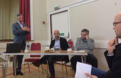 Robert Thorburn of BT addressing the digital forum meeting in Skeld on Saturday, as O2's Paul James and HIE's Stuart Robertson look on.