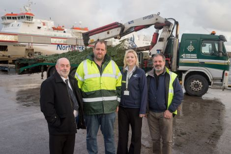 From left to right - Gary Bain of Living Lerwick, Robbie Leslie of Northwards, Charlene Moffat of Northlink and Neil Robertson of the SIC. Photo: Ben Mullay