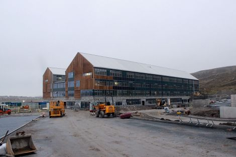 The school grounds are gradually emerging with the teachers' carpark on the right and the bus stop on the left .