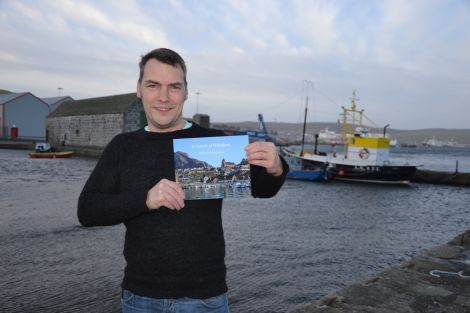 Fiddler Maurice Henderson proudly clutching a copy of his book In Search of Willafjord. Photo: Shetland News/Neil Riddell.