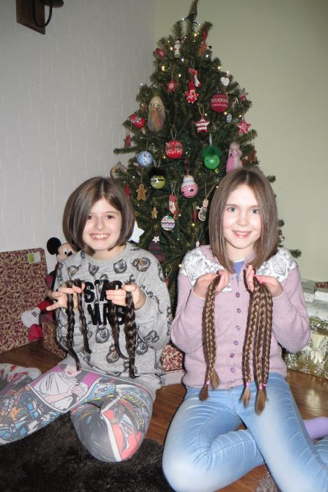 A new look just in time for Christmas: Faye Anderson and Lori Sutherland displaying their chopped-off locks.