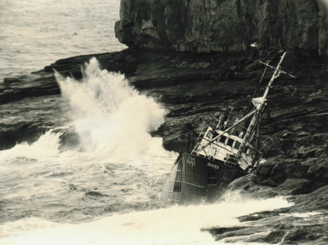 The trawler Juniper jammed against the rocks below 200 feet high cliffs at Papa Stour in 1967 - Photo: Dennis Coutts
