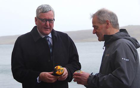 Scottish fishing minister Fergus Ewing with Shetland Fishermen's Assocation's Leslie Tait. Photo: Hans J. Marter/Shetland News
