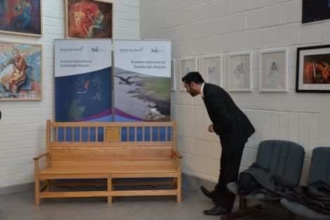 Yousaf inspecting the new bench, made by local firm Paparwark Furniture. Photo: Shetland News