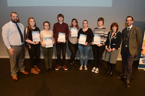 Youth volunteering development worker Neil Pearson (left), Voluntary Action Shetland executive officer Catherine Hughson (second from right) and Shetland Times editor Adam Civico (right) with the recipients of the summit awards (left to right): Imogen Teale, Rachel Keay, Thomas Hawick, Holly Cole, Mariel Leask, and Catriona Gilbertson - Photo:Dave Donaldson