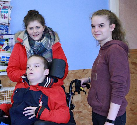 Volunteers Katie Leask (left) and Megan Brennan with Ryan Brennan - Photo: Hans J Marter/ Shetland News