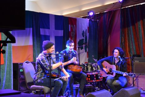 Prince Edward Island trio Ten Strings and a Goatskin telling one of several humorous anecdotes at Islesburgh on Friday afternoon. Photo: Shetland News