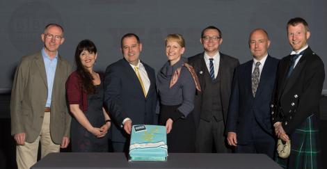 Radio Shetland team with senior BBC management (left to right): Sandy Bremner, managing editor Northeast and Northern Isles, Jane Moncrieff, John Johnston, Donalda MacKinnon, BBC Scotland director, Daniel Lawson, Mike Grundon and Richard Forbes - Photo: Malcolm Younger/Millgaet Media