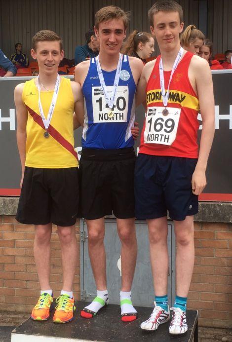 Seamus Mackay, centre, set a new Shetland senior record in winning the 800 metres.