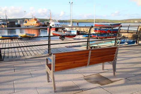 The bench overlooking Lerwick's small boat harbour, installed as a memorial for late lifeboat volunteer Ian Leask. Photo: Davie Gardner.