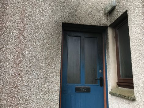 The visible damage to the front door and surrounds.