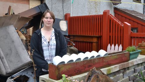 Helen Tait outside her Sandveien home, which was ravaged by fire at the weekend. Photo: Shetland News/Neil Riddell.