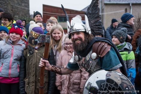 Guizer jarl Stewart Jamieson posing with the pupils from Bells Brae primary school.