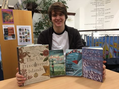 Library assistant Josh Smith with some of the most popular non-fiction books of the year.