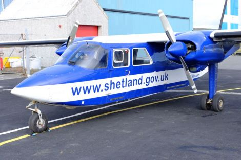 An islander aircraft in front of the hangar at Tingwall Airport. Photo: SIC