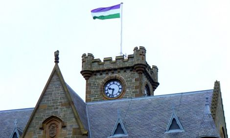 Lerwick Town Hall flying the #suffragette100 flag on Thursday to demonstrate Shetland Islands Council's support of International Women's Day. Photo: SIC
