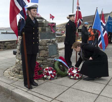 Wreaths were being laid at the Shetland Bus memorial on Sunday morning. Photo: Malcolm Younger/Millgaet Media
