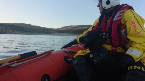 RNLI Aith crewmember Graham Johnston with the rescued dog Blue. Photo: RNLI/Nick McCaffrey