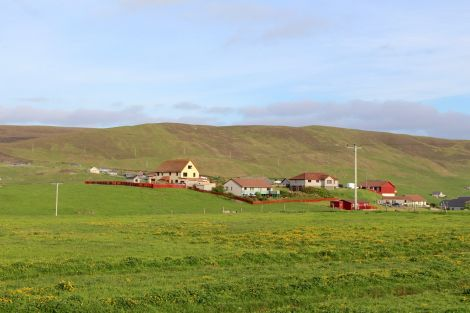 The housing would start at the north side of houses at Upper Scalloway, pictured here. Photo: Shetland News