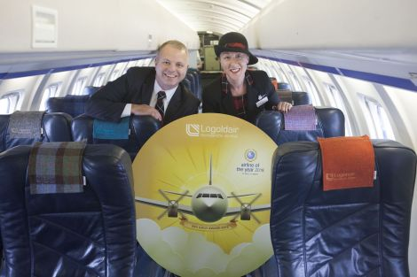 Managing director of Loganair Jonathan Hinkles and cabin crew member Sharon Williams showing off their gold award.